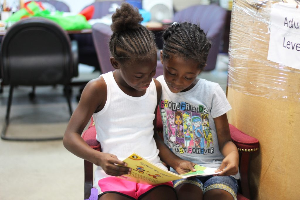 Cleveland Kids' Book Bank photo of two girls reading a book together