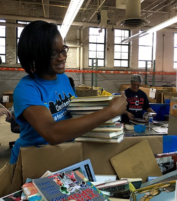 Volunteer sorting books at the Cleveland Kids' Book Bank
