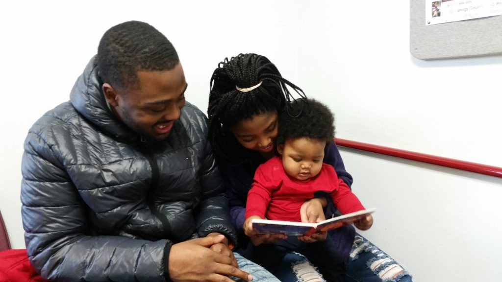 Cleveland Kids' Book Bank picture of a family reading together