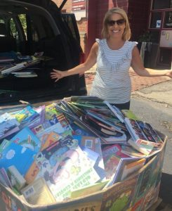 Annie A. delivers books collected in the bin at Guerney Elementary in Chagrin Falls.
