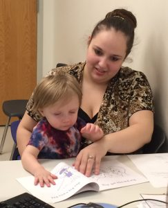 Mom and daughter reading together at WIC