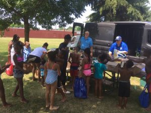 Chesterland Rotary Bookmobile distributing books for the Cleveland Kids' Book Bank