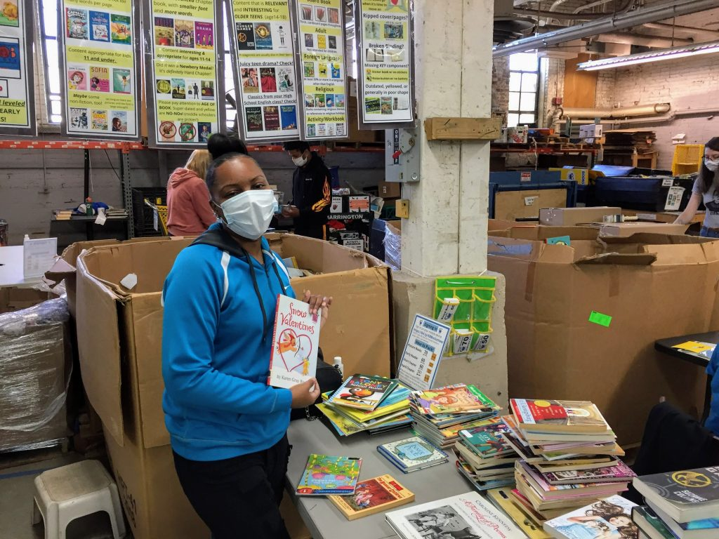 Cleveland Kids' Book Bank volunteer packing books